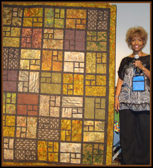 quilter with quilt